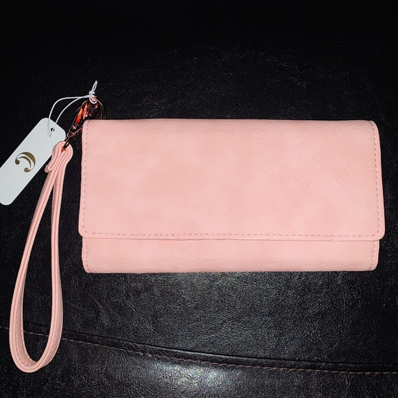 Charming Charlie Handbags - Soft pink wrislet